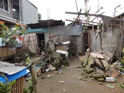 Typhoon damaged house in SPDOWFI community