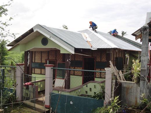 SPDOWFI Staff House with new roof being installed